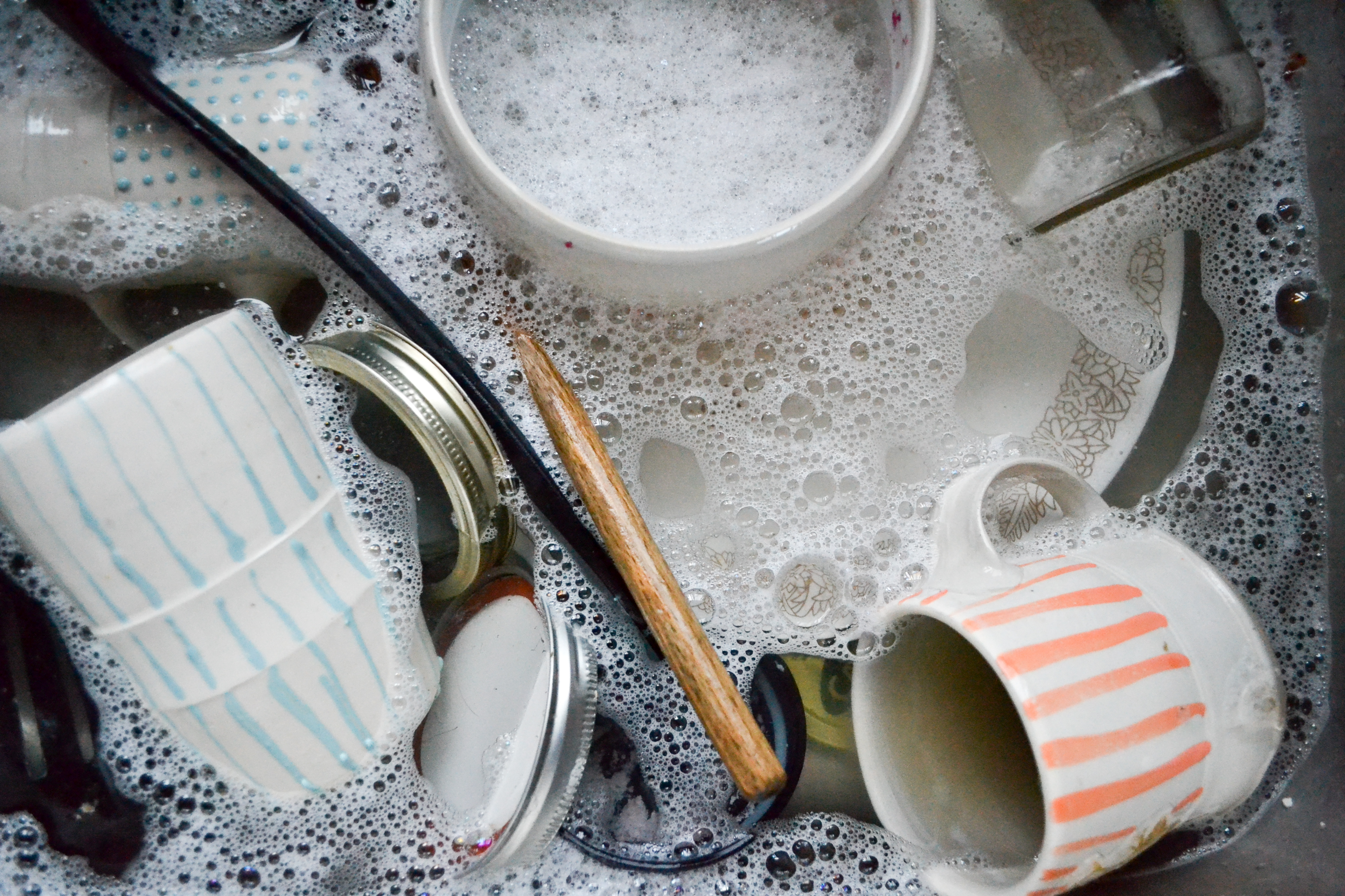 Always doing dishes. – B Practical Pottery Washing Dishes